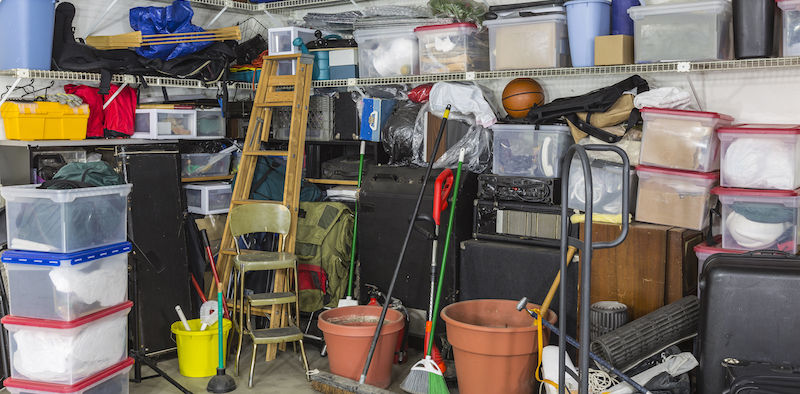 Residential garage full of junk